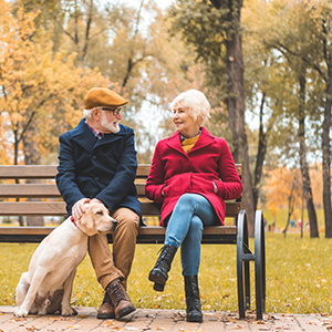 Elderly Couple with Dog